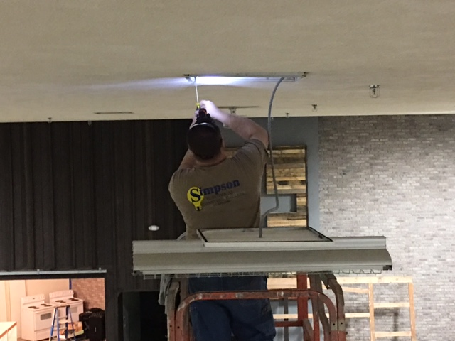 Simpson Electrical Construction Co. installing efficient lighting
